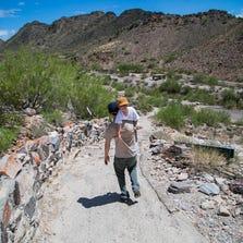 Phoenix may start charging a parking fee at trailheads, including Piestewa Peak, where Yosef Steinmetz and son Daniel were hiking Friday.