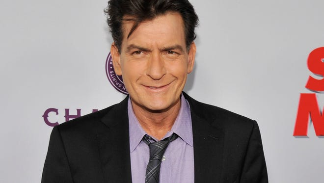 In this April 11, 2013 file photo, Charlie Sheen poses at a Los Angeles premiere.