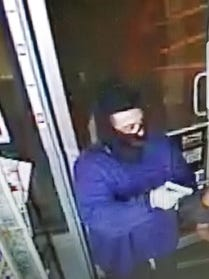 Police are searching for a suspect who robbed a business at gunpoint Monday in Lafayette.