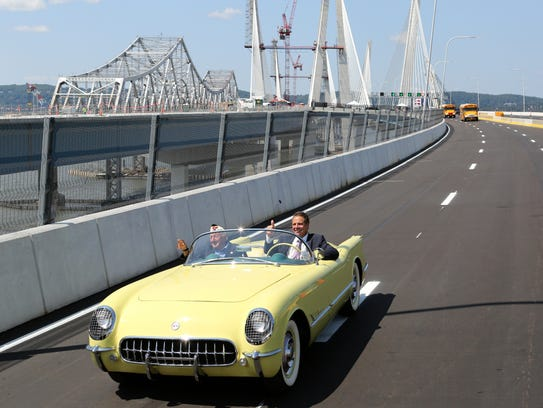 Gov. Andrew Cuomo, driving a yellow 1955 Corvette with
