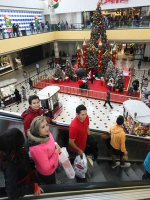 Ana Yvette Fragoso, bottom, of Juárez, shops at Cielo Vista Mall with her children during Black Friday in 2016.