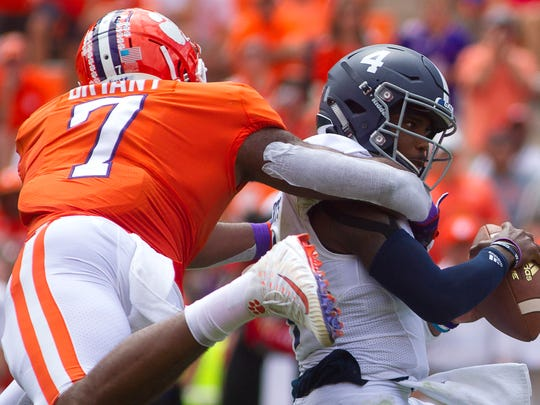 Sep 15, 2018; Clemson, SC, USA; Clemson Tigers defensive end Austin Bryant (7) brings down Georgia Southern Eagles quarterback Shai Werts (4) during the first quarter at Clemson Memorial Stadium. Mandatory Credit: Joshua S. Kelly-USA TODAY Sports