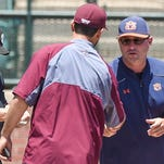 Auburn coach Butch Thompson exchanges lineup cards with Mississippi State assistant coach Nick Mingione Sunday at Plainsman Park. Mississippi State would defeat Auburn 10-3 on May 15, 2016.