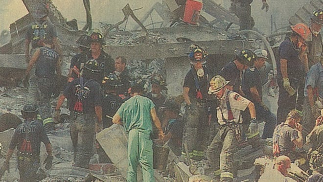 Dr. Brian Martin (center, in scrubs) rushed to help first responders after terrorist attacks on the World Trade Center on Sept. 11, 2001.