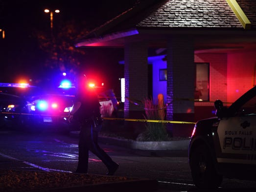 Sioux Falls police secure the scene at the McDonald's