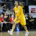 Ohio State's Kelsey Mitchell (3) drives past Tennessee's Bashaara Graves, left, Friday night in Sioux Falls, S.D.