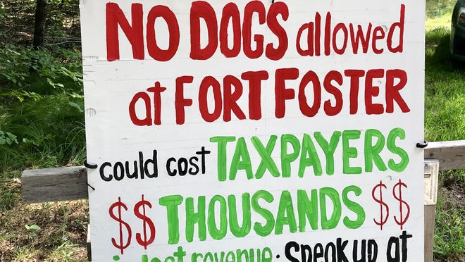Signs around Kittery are pushing back against a proposal to restrict dogs at town beaches.