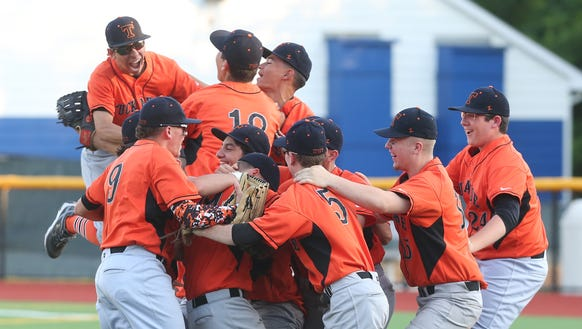 Tuckahoe players celebrate their 9-5 victory over Pawling