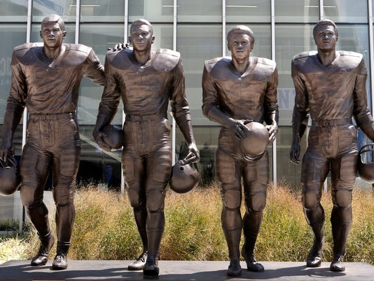 The statue outside Kentucky football's practice facility