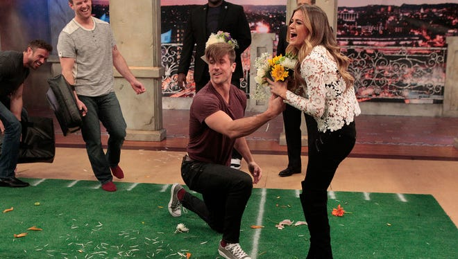 """Jordan Rodgers pretends to propose to JoJo Fletcher during one of the drills that was part of a challenge themed around ESPN's """"SportsNation"""" on Monday's episode of """"The Bachelorette."""""""
