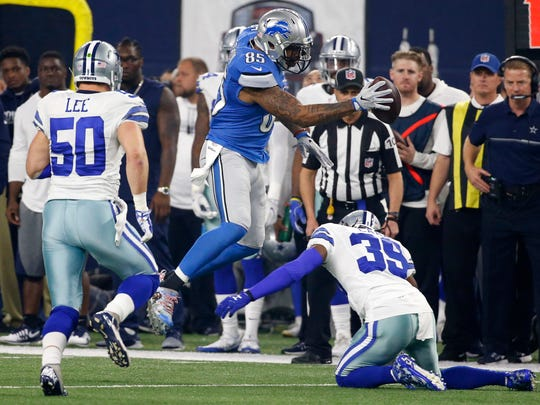 Detroit Lions tight end Eric Ebron, center, leaps over a tackle attempt by Dallas Cowboys' Brandon Carr (39) as Sean Lee (50) watches in the first half of an NFL football game, Monday, Dec. 26, 2016, in Arlington, Texas. (AP Photo/Michael Ainsworth)