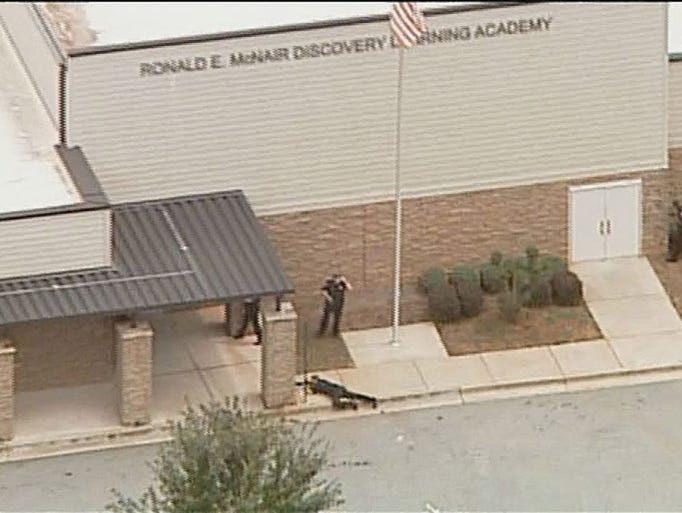 Police secure an entrance following a reported shooting at Ronald McNair Discovery Learning Academy in Decatur, Ga., on Aug. 20. A spokesperson with DeKalb County Schools says a lone shooting suspect was taken into custody.