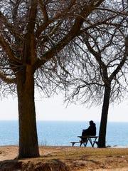 """It took a long time getting here,"" said Irwin Matthews of Milwaukee referring to the warmer weather, as he enjoyed some sunshine Wednesday along Lake Michigan near Bradford Beach."