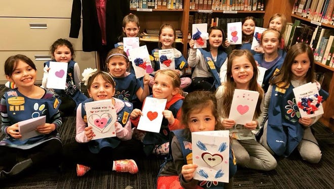 Girl Scout Troop 60492 of Brockport showing the cards they made for Bobby's Valentines. The organization is named for Cpt. Robert Bager, a 2002 graduate of the College at Brockport, who was killed in active military service in 2005 from injuries sustained in a training accident in Germany.