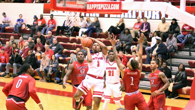 Detroit Mercy's Corey Allen goes up for a basket against Western Kentucky Saturday. The Titans won 85-79.