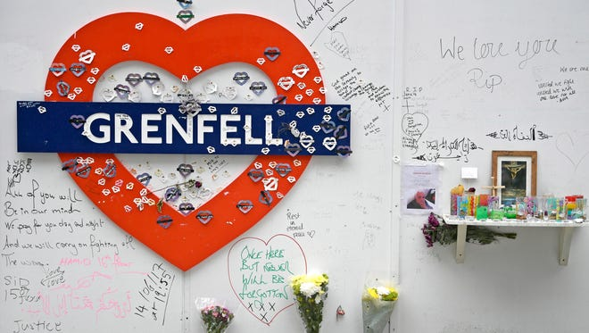 Tributes to the victims of the Grenfell Tower fire are displayed in London on June 13, 2018, on the eve of the tragedy's first anniversary.
