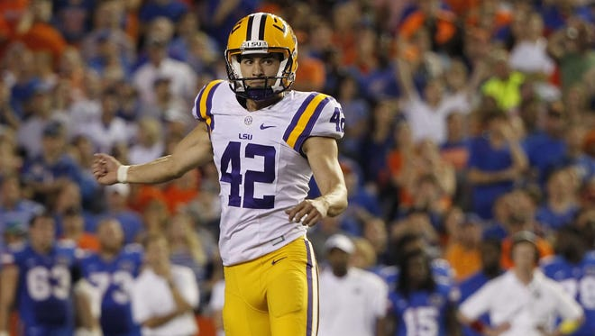 LSU Tigers place kicker Colby Delahoussaye (42) reacts after he kicked the game winning field goal during the fourth quarter against the Florida Gators at Ben Hill Griffin Stadium.