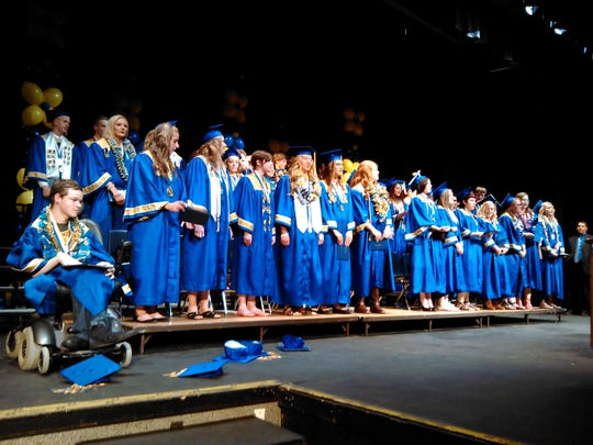 Students sing the PHS school song to end the Class of 2015 graduation festivities.