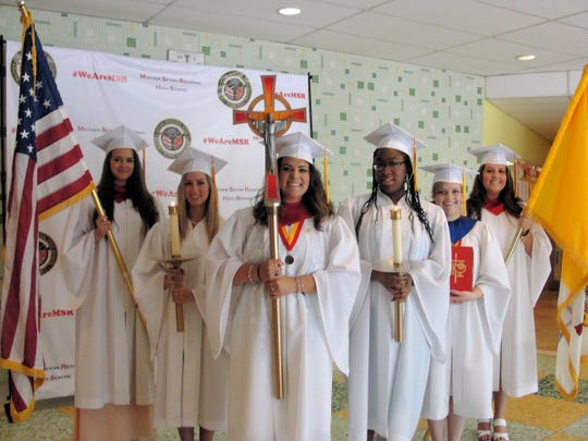 Students leading the commencement procession at Mother Seton Regional High School (from left): U.S. Flag: Alexandra Rego, Candle-Bearer: Brianna Perez, Cross: Sabrina Garcia, Candle-Bearer: Alexis Thomas-Evans, Lectionary: Sarah Dedinsky and Papal Flag: Diana Oliveira.