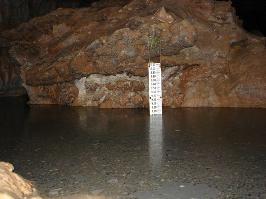 This 2006 photo provided by The National Park Service shows a gauge that measures the rise and fall of the Madison Aquifer water level at Calcite Lake in The Wind Cave National Park in the Black Hills of South Dakota. The underground lakes, which were discovered in the 1960s, aren't home to any animal life but prominent cave microbiologist Hazel Barton has discovered there is bacteria - albeit scant - in the lakes. Barton hopes to decipher how the bacteria survives and answer questions about how it interacted before multicellular organisms came along and perhaps find new sources of antibiotics.