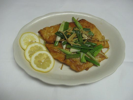 Pan-fried cod filet with ginger and scallions