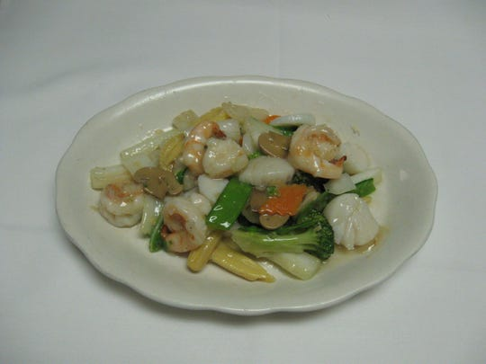 Treasure of the Sea with shrimp, scallops and vegetable in white sauce.