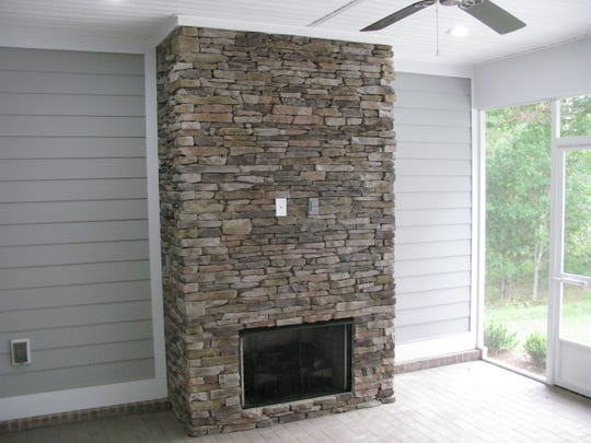 Stonework in fireplace at home on Sumter Hill Lane built by Adams Quality Homes.