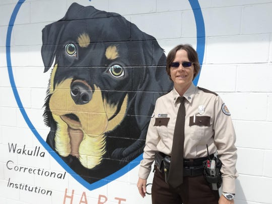 Sergeant Jeanne Maddox, an enthusiastic supporter of inmates' involvement in the HART program working with rehabilitated dogs and the art projects which now cover multiple walls with original murals. She says working together on art projects such as the one found in the Visitor room is a way the inmates can do good for others and better themselves in the process.