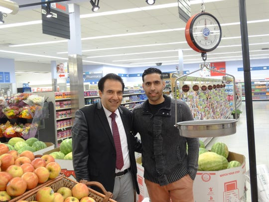 Fresh Emporium owner Neftali Medina, left, and son Grisnaldy Medina, welcome customers to their new supermarkets.
