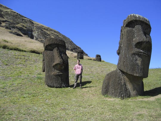 In this Sept. 23, 2015, photo, provided by small business owner Mike Scanlin, Scanlin poses for a photo on Easter Island in the South Pacific, a Chilean territory.