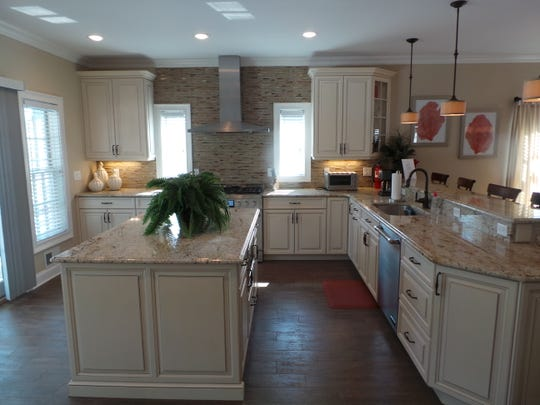 The kitchen at 111 New Jersey Ave. in Point Pleasant Beach comes with custom cabinetry and beautiful granite counter tops.