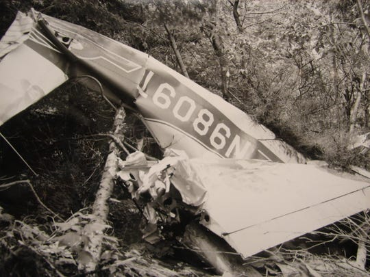 The inverted wreckage of Dr. and Mrs. Herbert Brooks' plane as it was found when the first investigators arrived at the crash scene in 1967 on Haystack Mountain, two years after the plane vanished.