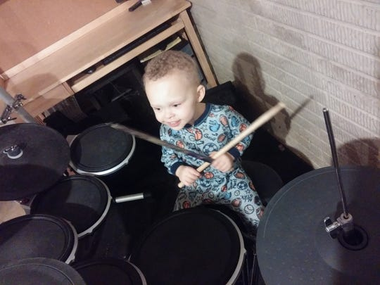 Jaxon Brown, 2, at his father's drum set. The former