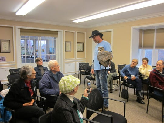 "A naturalist from Cedar Run Wildlife Refuge in Medford gives a talk during The Nature Conservancy's ""Owls Up Close"" seminar, held at the Kay Environmental Center earlier this month."