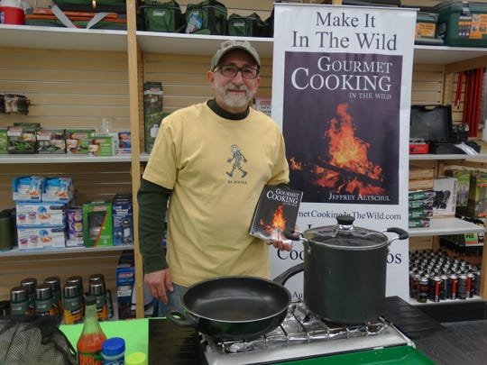 """Camping enthusiasts enjoy a cooking demonstration by Jeff Altshul, author of """"Gourmet Cooking in the Wild."""""""