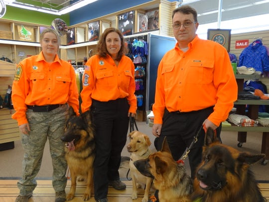 Kristen Ryan, center, with members of the New Jersey K-9 Search and Rescue team.
