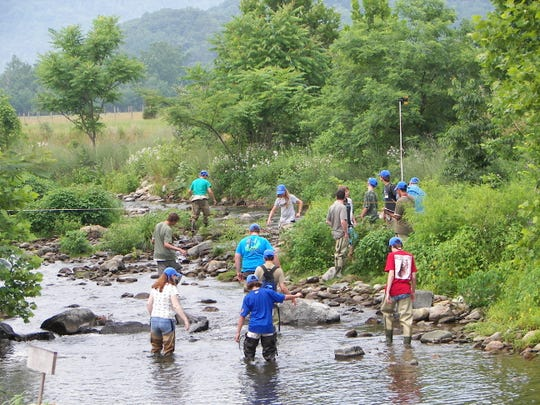 Children at the TU Tri-State Conservation Camp involved in a hydrology study.