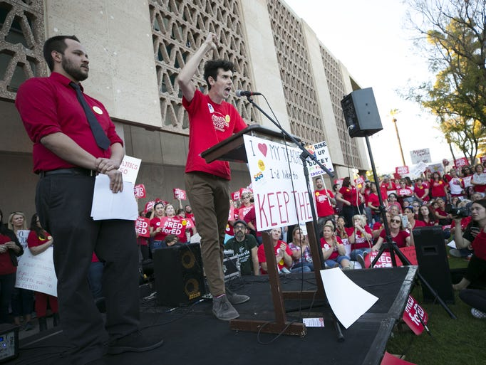 Noah Karvelis, (center) a teacher and leader in Arizona