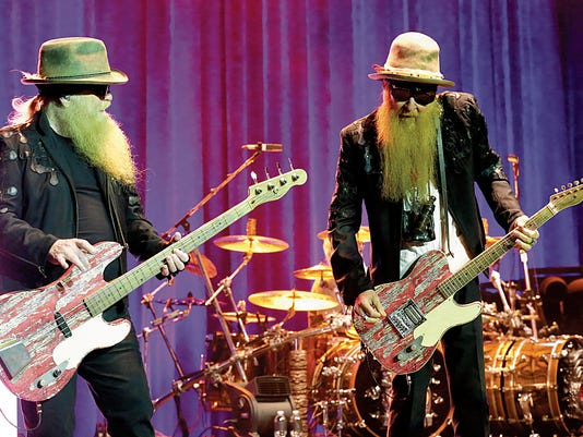 RUBEN R RAMIREZ?EL PASO TIMES ZZ Top band members Dusty Hill (L) and Billy Gibbons hit the stage and never stopped playing along with drummer Frank Beard to a Sold Out Abraham Chavez Theatre show.