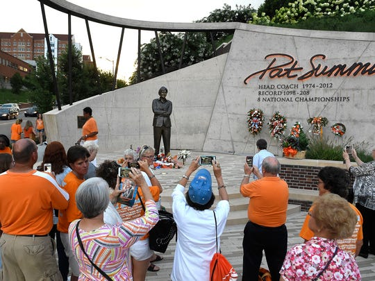 Fans take photos with Pat Summitt's statue outside