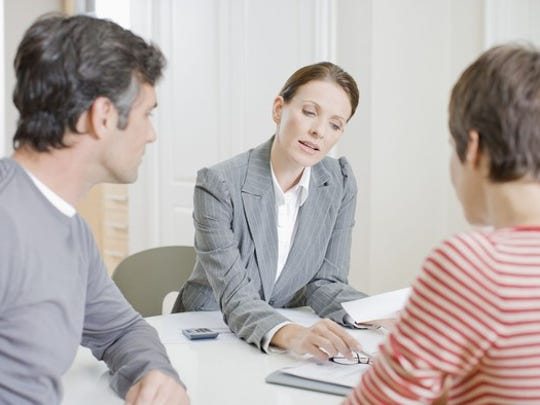 Couple looking over documents with mortgage lender