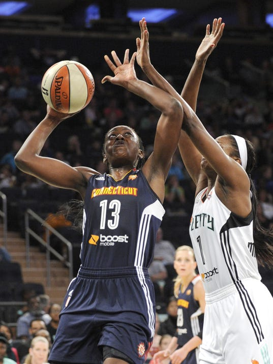 Connecticut Sun forward Chiney Ogwumike, left, shoots as New York Liberty forward Delisha Milton-Jones defends during the second quarter of a WNBA basketball game on Friday, June 13, 2014, at Madison Square Garden in New York. (AP Photo/Bill Kostroun)