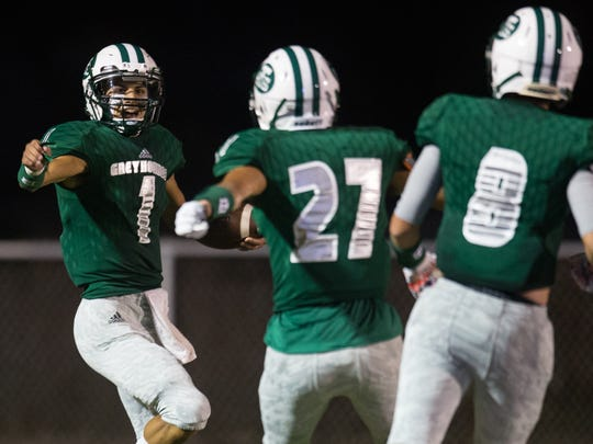 Taft's quarterback Elias Carrera celebrates after scoring a touchdown during the third quarter of their game against Aransas Pass at Akins Wildcat Stadium in Portland on Friday, Sept. 15, 2017.