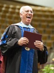 A-B Tech President Dennis King at a commencement ceremony at the U.S. Cellular Center.