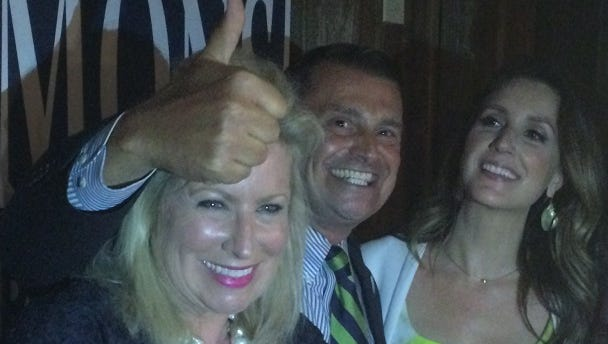 A victorious Peter Simmons celebrates capturing the Bonita Springs mayor's seat with his wife, SueZahn, left and supporters.