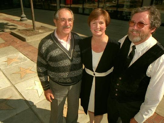 From left: Bernard Shifrin, Helene Yelverton and and David L. Agard, stand on the sidewalk which contains their personalized stars for being inducted into the Walk of Fame located outside of the Metro Center in downtown Binghamton. The three were inducted in 1996.