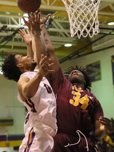 Washington's Tyree Ellis tries for a basket as Vincent's