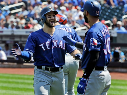 Texas Rangers' Joey Gallo, left, celebrates his home run with Nomar Mazara during the first inning of a baseball game against the New York Mets at Citi Field, Wednesday, Aug. 9, 2017, in New York. (AP Photo/Seth Wenig)