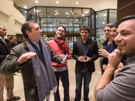 Republican presidential candidate, Sen. Ted Cruz, R-Texas jokes with members of the media that spotted him from the bar of the downtown Marriott after checking in at 11:50 p.m. Tuesday, Jan. 26, 2016.