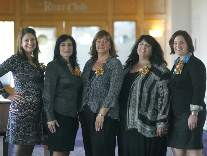 2013 Up & Coming Businesswomen honorees are, from left,